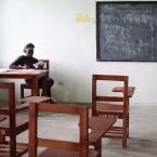 Nancy Quaye works on her math lessons at Beajah Public School, in Beajah, Liberia on June 24, 2015.