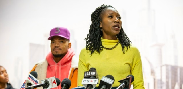Amara Enyia speaks during a press conference in which Chicago-born, Grammy-award winning artist Chance the Rapper (left) endorses her for Chicago mayor.