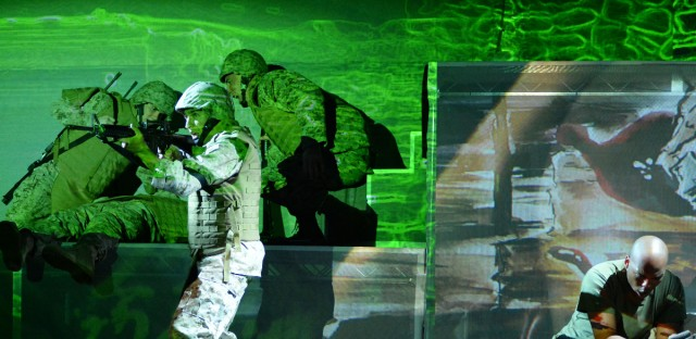 Actors onstage during a performance of Fallujah. The Long Beach Opera production is based on the combat experiences of a U.S. Marine in Iraq, and was co-written with an Iraqi-American.