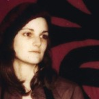 """This iconic photograph became one of the most famous images of the 1970s,"" Jeffrey Toobin says. It shows Patty Hearst standing in front of a Symbionese Liberation Army flag several months after she was kidnapped."