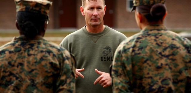 """1st Sgt. John Dober speaks to a group of Marines at Camp Lejeune. Dober, who served in combat in Iraq and Afghanistan, says the Marines owe the troops """"the best possible chance to bring them home alive."""""""