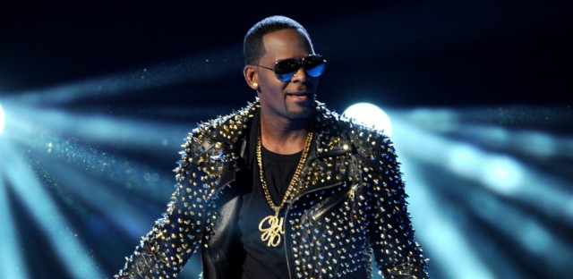 "In this June 30, 2013 file photo, R. Kelly performs at the BET Awards in Los Angeles. In his first interview since being charged with sexually abusing four people, including three underage girls, R. Kelly says he ""didn't do this stuff"" and he's ""fighting for his life. Kelly gave the interview to Gayle King of ""CBS This Morning,"" with excerpts airing Tuesday night, March 5, 2019, and the full interview airing Wednesday and Thursday morning."