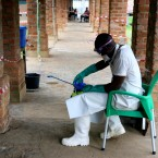 A health care worker wears virus protective gear at a treatment center in Bikoro Democratic Republic of Congo on Sunday, May 13, 2018.