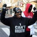 person wearing I can't breathe shirt