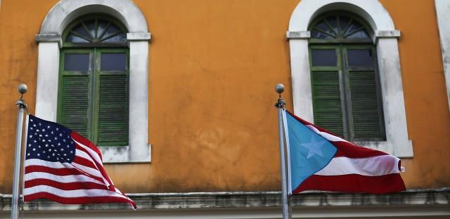 A U.S. flag flies beside a Puerto Rican flag in Old San Juan.