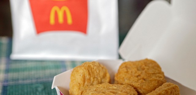 In this March 4, 2015 file photo, an order of McDonald's Chicken McNuggets is displayed for a photo in Olmsted Falls, Ohio. McDonald's is testing Chicken McNuggets with no artificial preservatives as it works to revive its U.S. business. The world's biggest hamburger chain says it began testing the new recipe in about 140 stores in Oregon and Washington in March 2016.