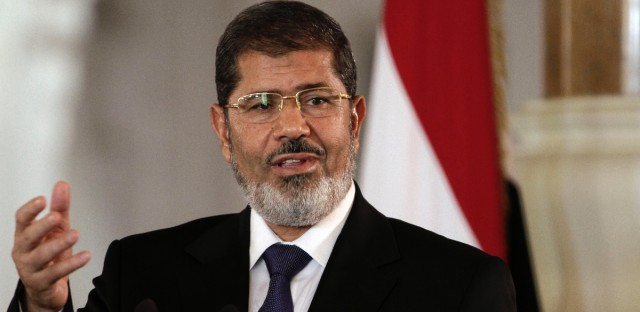 In this July 13, 2012 file photo, then Egyptian President Mohammed Morsi speaks to reporters at the presidential palace in Cairo. Egyptian prosecutors on Saturday, Dec. 21, 2013, referred the ousted president to a third trial, on charges of organizing prison breaks during the 2011 uprising, spreading chaos in the country and abducting policemen in collaboration with foreign militants.