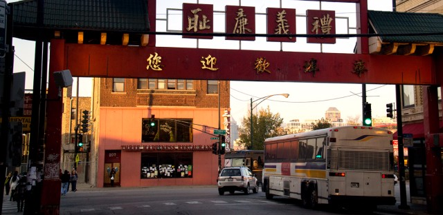 A tour bus passes through the Chinatown gate on Wentworth Avenue in November 2016.