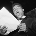 Muhammad Ali reads one of his poems during a contest at the Bitter End, a Greenwich Village coffeehouse and nightclub, in 1963.