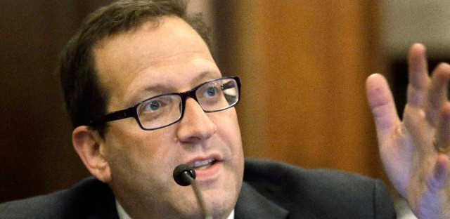 """Illinois state Sen. Ira Silverstein, D-Chicago, speaks at the Illinois State Capitol in Springfield in May 2017. Silverstein has been cleared of sexual harassment allegations levied by a victims-rights advocate, but an inspector general has found his behavior toward her """"was not becoming of a legislator."""""""