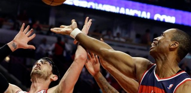 File: In this April 17, 2013 file photo, Washington Wizards center Jason Collins, right, battles for a rebound against Chicago Bulls guard Kirk Hinrich. Collins is the first male professional athlete in the major four American sports leagues to come out as gay.