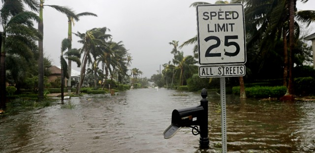 A street is flooded near the ocean after Hurricane Irma passed through Naples, Fla., Sunday, Sept. 10, 2017.