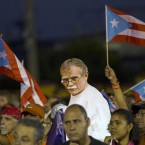 Puerto Rican activists show a picture of independence fighter Oscar López Rivera
