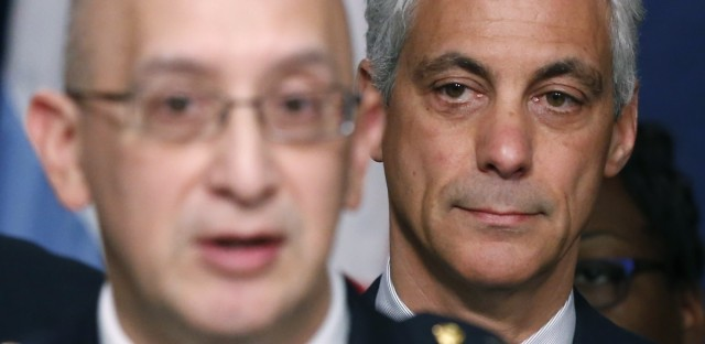 Chicago Mayor Rahm Emanuel, right, listens to Police Superintendent John Escalante during a news conference about new police procedures on Wednesday, Dec. 30, 2015, in Chicago.