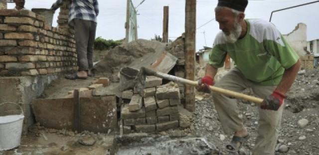 An Uzbek man builds a new house outside the southern city of Osh, Kyrgyzstan.