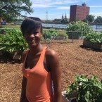 Nateba Yates, a resident of Evergreen Terrace since 2009, in the Evergreen Terrace Vegetable Garden