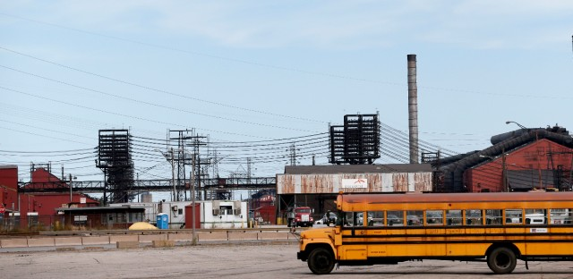 This Sept. 14, 2016 photo shows factories in East Chicago, Ind. The mayor of this industrial town ordered the evacuation of a 40-year-old public housing complex this summer because of severe lead contamination, forcing more than 1,000 people from their homes.