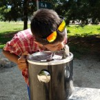Kid drinking out of water fountain