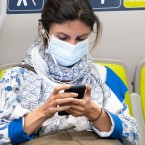 Health officials have identified what could be the first U.S. case of the novel coronavirus spreading within the general population. But a hospital says the diagnosis was delayed for days. Here, a passenger wears a face mask on a train in San Francisco on Wednesday.