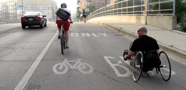 Cyclists commuting on Milwaukee Avenue in Chicago.