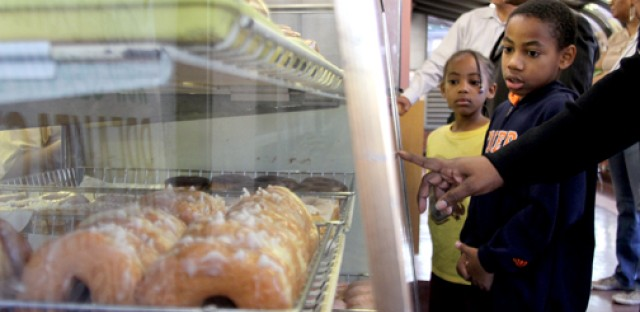 The Williams family picks out their favorite doughnuts at Dat Donut in Chicago's Chatham neighborhood. The Williams family joined Curious City on its first ever doughnut crawl to help decide which privately-owned doughnut shop is the best.