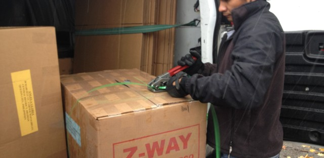 Local shipping companies for Filipinos regularly pick up hefty care packages, or 'balikbayan boxes,' to deliver to family members abroad. Several Chicago-area companies are now using the system for typhoon relief efforts.