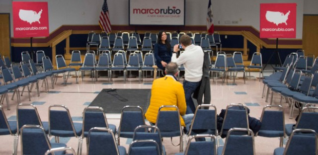 Caucus tourists from the Netherlands, Lars Duursma, yellow coat, Victor Vlam, right, and Bertine Moenaff are pictured after Republican presidential candidate Marco Rubio spoke at Marshalltown Community College in Marshalltown, Iowa, January 26, 2016, ahead of the Iowa caucuses.