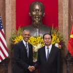 President Obama shakes hands with Vietnamese President Tran Dai Quang at the Presidential Palace in Hanoi on Monday. Obama's Vietnam trip is the latest in a series of moves reaching out to old U.S. rivals.