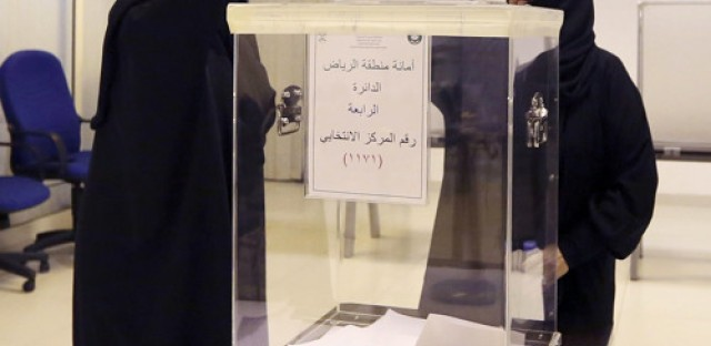 Women vote for the first time in Saudi Arabian history, and some are elected