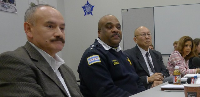 Chicago police Supt. Eddie Johnson, second from left, takes questions from news reporters at the start of the panel's first meeting Tuesday. The 12 panelists include, from left, Ald. Ariel Reboyras (30th Ward), community representative Jim Lew and Deputy Mayor Andrea Zopp.