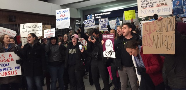 Protesters at Terminal 5 of O'Hare International Airport Saturday night.