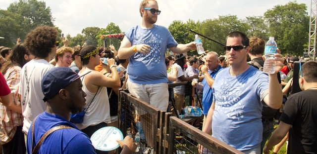 Festival volunteers hand out water bottles on Sunday.