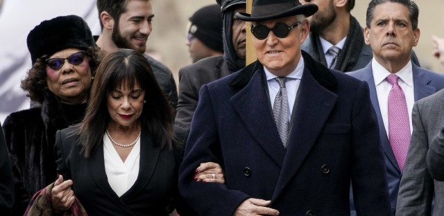Roger Stone, former adviser to President Trump, arrives at the E. Barrett Prettyman U.S. Courthouse on Thursday in Washington, D.C., with his wife, Nydia.