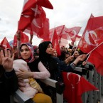 Supporters of Turkey's President Recep Tayyip Erdogan gather for a rally outside the Presidential Palace, in Ankara, Turkey, Monday, April 17, 2017, one day after the referendum. Turkey's main opposition party urged the country's electoral board Monday to cancel the results of a landmark referendum that granted sweeping new powers to Erdogan, citing what it called substantial voting irregularities.