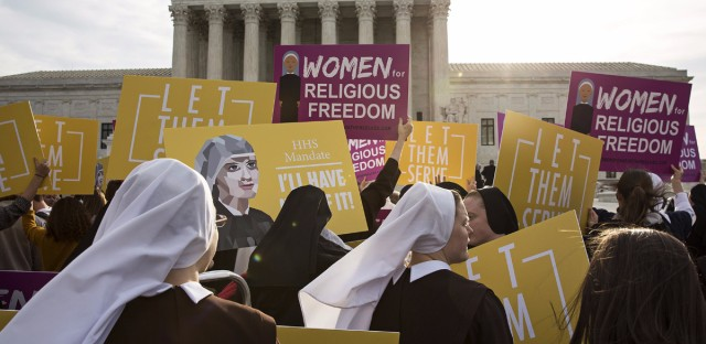 Nuns and others opposed to the Affordable Care Act's contraception mandate rally outside the U.S. Supreme Court Wednesday. Drew Angerer/Bloomberg via Getty Images