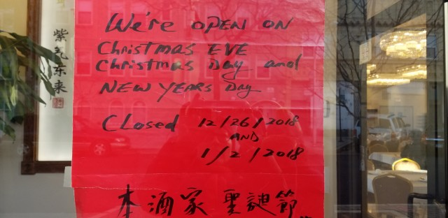 Hon Kee Restaurant in Uptown puts up a sign to remind customers that it's open for business through the holiday.