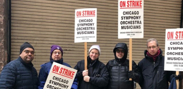 Musicians at the Chicago Symphony Orchestra on the picket line March 11, 2019, after talks with management on a new contract broke down. Chris Lewis, far left, is a stage manager who is not crossing the picket line in support. CSO musicians are in their seventh week on strike.