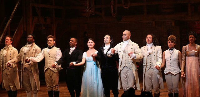 Leslie Odom Jr., Phillipa Soo and Ariana DeBose with Lin-Manuel Miranda with the cast during their final performance curtain call of Hamilton in July.