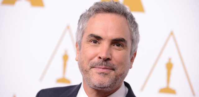 Alfonso Cuarón arrives at the 86th Oscars Nominees Luncheon, on Monday, Feb., 10, 2014 in Beverly Hills, Calif.