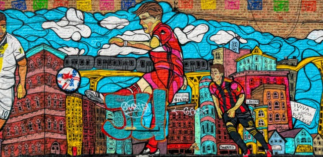 Mural by Sam Kirk seen on 18th Street in the Pilsen area of Chicago.