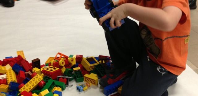 Pritzker school kindergartener, Leo, plays with LEGOs at Chicago Public Schools downtown headquarters.