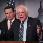 Sen. Bernie Sanders, I-Vt., joined at left by Sen. Chris Murphy, D-Conn., holds a news conference after the Senate passed a resolution he introduced that would pull assistance from the Saudi-led war in Yemen, a measure to rebuke Saudi Arabia after the killing of journalist Jamal Khashoggi, at the Capitol in Washington, Thursday, Dec. 13, 2018.
