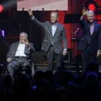 Former Presidents, from right to left, Barack Obama, Bill Clinton, George W. Bush, George H.W. Bush and Jimmy Carter wave on stage at the opening of a hurricane relief concert in College Station, Texas, Saturday.