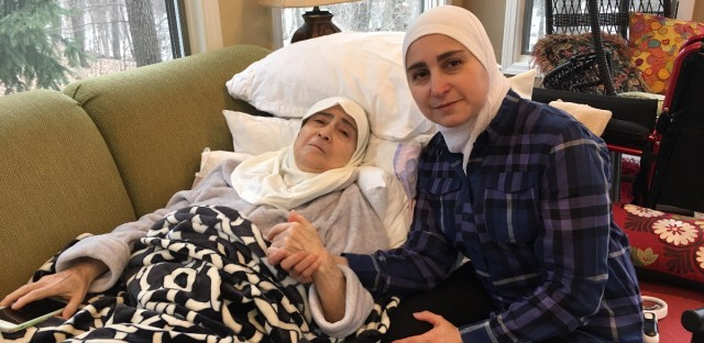 Nour Ulayyet sits with her sick mother in her Valparaiso, Indiana. Ulayyet's sister was set to arrive from Syria over the weekend, but was denied entry into the U.S. after President Donald Trump's executive order.