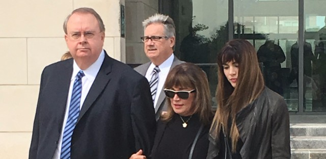 Lake County, Indiana Sheriff John Buncich, left, leaves the federal courthouse in Hammond after being found guilty on five counts of wire fraud and one count of bribery.