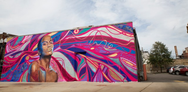 """The new mural """"The Love I Vibrate"""" is painted on the side of the Howard Brown Health clinic in Chicago's Boystown neighborhood."""