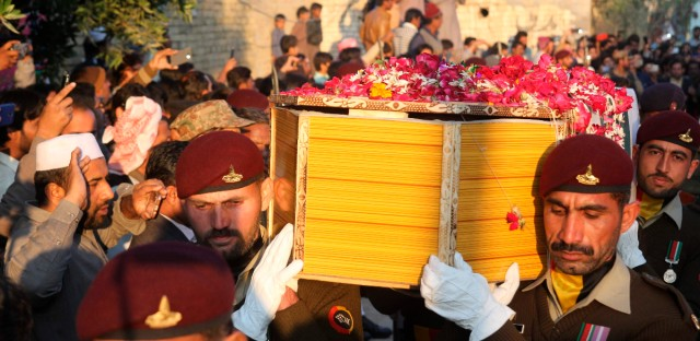 Pakistani soldiers carry a coffin of Pakistani soldier Khuram Ali who reportedly lost his life during heavy shelling from Indian troops at the Line of Control in Pakistani Kashmir, during his funeral in Dera Ghazi Khan in Pakistan, Monday, March 4, 2019. A key train service with neighboring India resumed and schools in Pakistani Kashmir opened Monday in another sign of easing tensions between the two nuclear-armed rivals since a major escalation last week over the disputed Kashmir region.