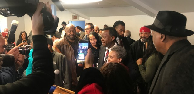 Willie Wilson and Lori Lightfoot join a crowd of religious and community leaders at the Chicago Baptist Institute in Washington Park on Friday, March 8, 2019.