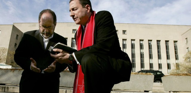 The Rev. Rob Schenck, of the National Clergy Council, right, and the Rev. Patrick Mahoney, director of the Christian Defense Coalition, pray in front of the J. Barrett Prettyman Federal Courthouse in Washington, D.C., in 2005. Schenck is a pro-life activist who believes gun ownership and the use of guns is a decision best decided by community leaders, not the government.