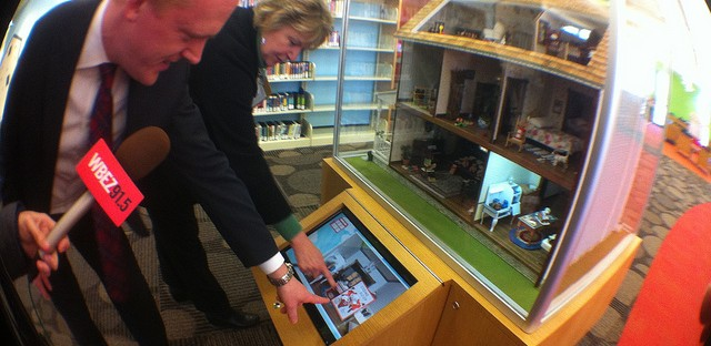 Library administrators at Arlington Heights Memorial demonstrate an interactive dollhouse in the children's area.